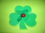 Design 1A: This shamrock is reinforced with a lighter shade of craft foam.  In the center is a netting bow topped by a lady bug.