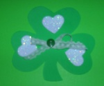 Design 2B: Glue white foam heart punches one each leaf of the shamrock.  Add a seam binding bow topped with a button in the center.