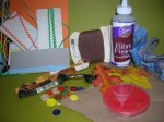 1. Assemble supplies. Select fall colored craft materials (thread, ribbon, trim, etc.).