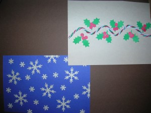 "Snowflake Card: Save those mis-punched snowflakes then glue them to the edges of the card for a complete ""snowy"" look. I used 3 sizes of snowflake punches.Holly Card:  Run a line of glue across the card in a wavy pattern.  Then glue a piece of yarn to the page.  Let dry and then accent with holly and berries (martha Stewart Holly & Berries punch).  The berries the punch makes are way small so I punch bigger berries with a regular hole punch.."