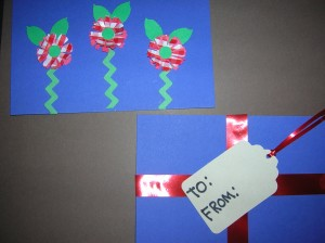 Flower Card:  Use rick-rack or use a zig-zag punch (EK Sucess) to make paper rick-rack for the stems.  I used a comos punch to punch a flower from red construction paper and red gingham wrapping paper.  Glue them together and glue a 1/2 inch round punch as the center.  Glue to card and when dry bend the petal up to create a 3D effect.Present Card:  Simply glue ribbon in a criss-cross pattern and then use a jumbo Recollections tag punch to make a tag.  Write a message on the tag and you're done!.