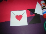Glue the heart seal on the envelope.