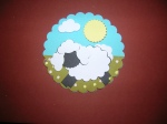 Glue the sheep, sun and cloud in place.